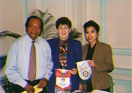 Exchanging Rotary flags at Jakarta meeting